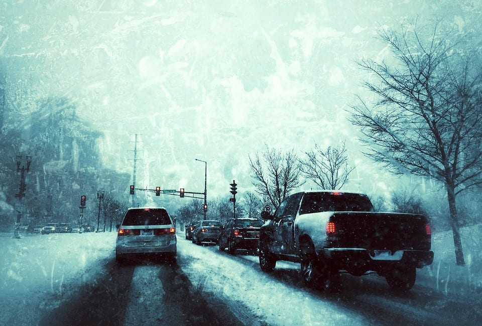 cars driving on snow covered road