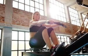 A woman doing the Indoor- Rowing exercise - Indoor Rowing also helps to burn a considerable amount of Calories