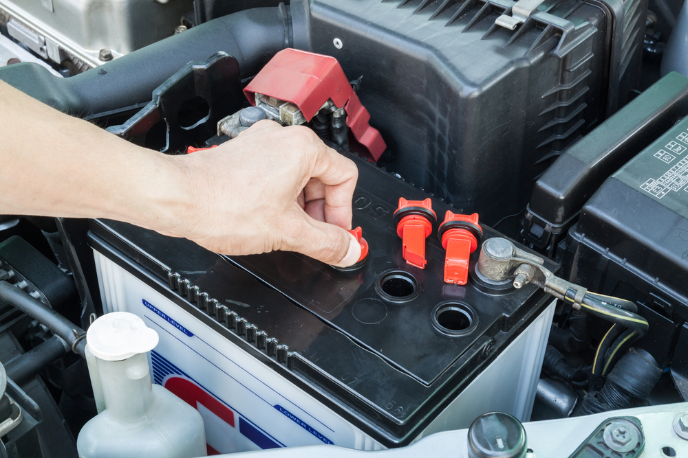 man checking car battery