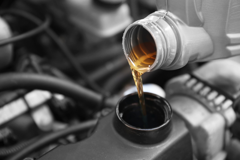 oil pouring into car