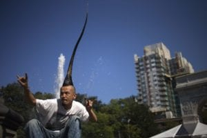 "apanese fashion designer Kazuhiro Watanabe, holds the weird world record for having the ""Tallest Mohawk,"""