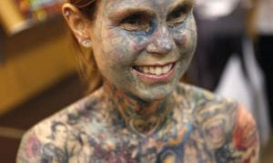 Julia Gnuse was the most tatooed world woman in the world and she set this world record due to a serious condition