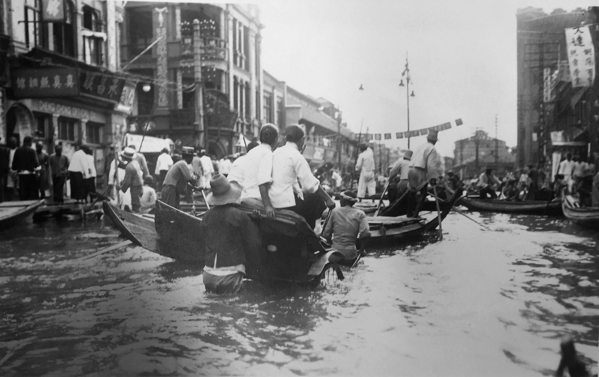 Rickshaw pullers working the flooded street