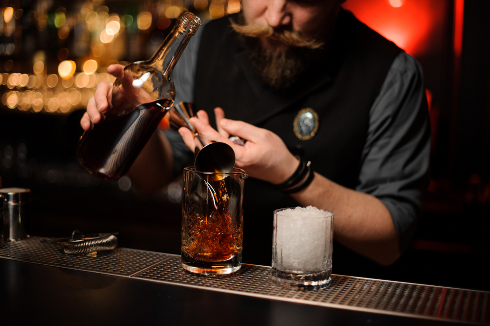 bartender pouring a drink