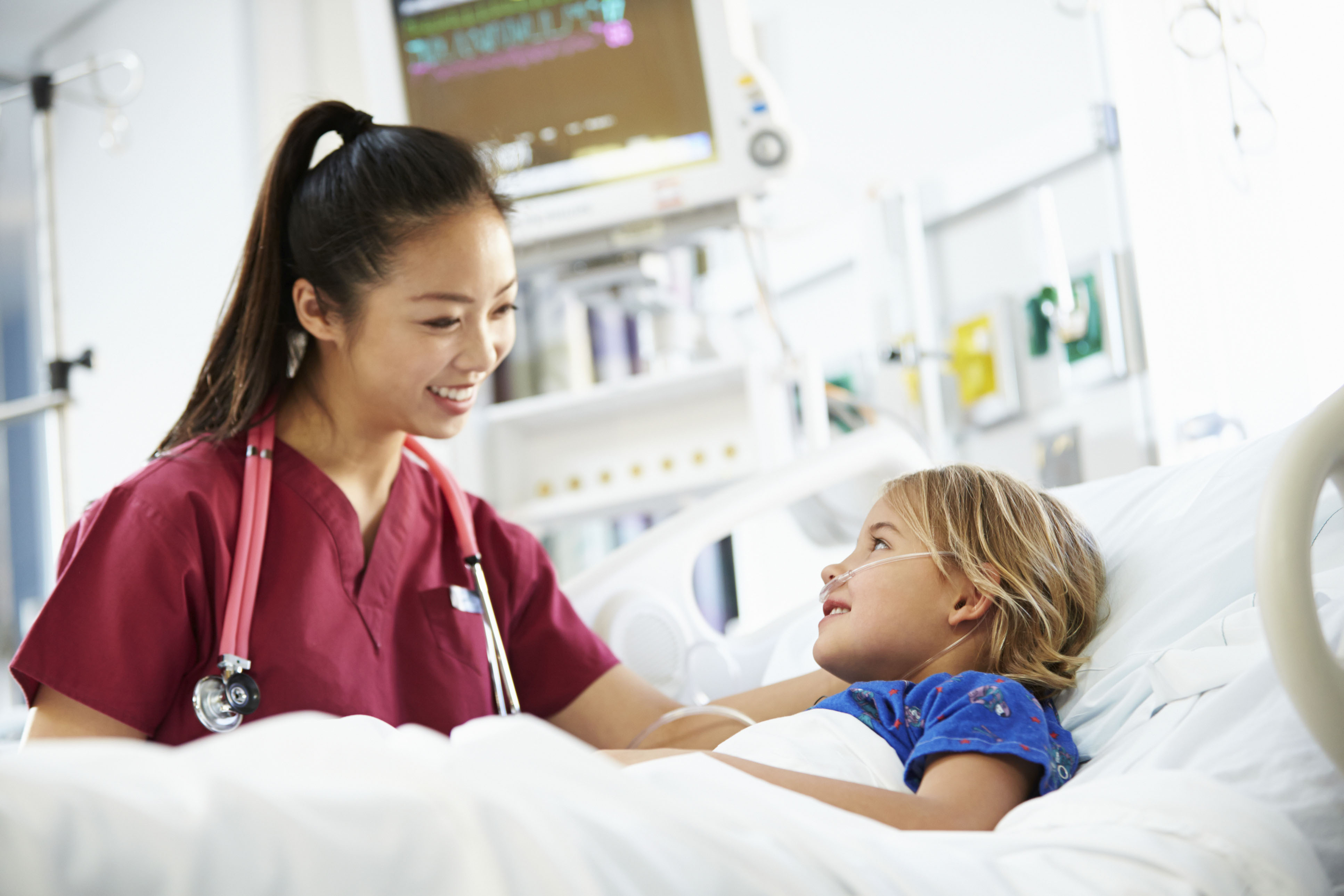 A registered nurse attending to a child - It is one of the best jobs that doesn't require a degree that pays good money