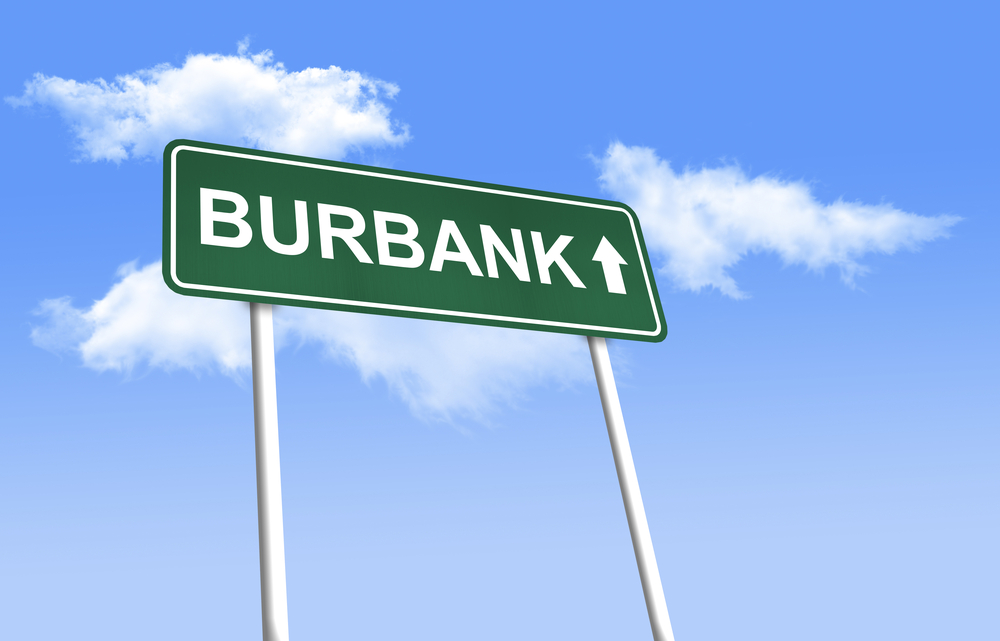 Burbank. Green road sign (signpost) on blue sky background.