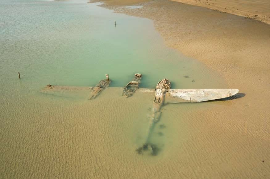 A World War II Plane washing up on a beach in 2007