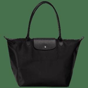 female travel longchamp purse