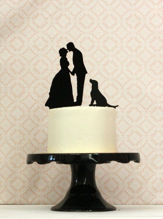 wedding cake topper with dog and couple silhouettes