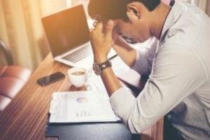 travel insurance claim stressed man