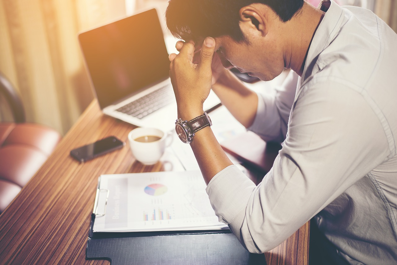 travel insurance claims stressed man