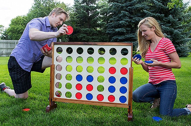 playing backyard games in the summer - connect 4 in a row