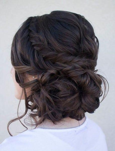 wedding updos: messy low braided bun