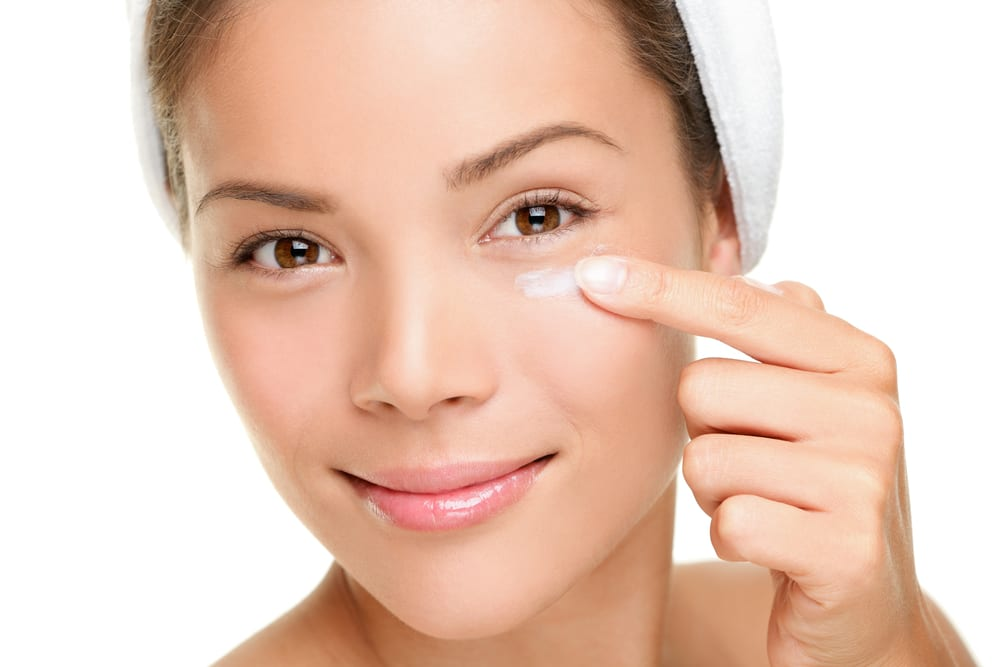 Woman applying her best under-eye cream