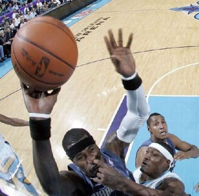 funny sports photos | basketball slam dunk with finger in nose