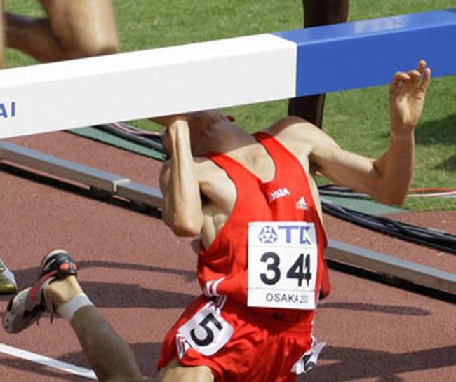 funny sports photos | face hitting hurdle