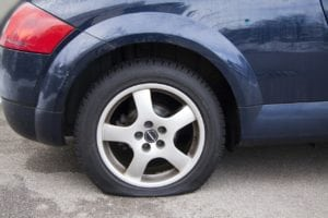 how to change a flat tire car with flat tire