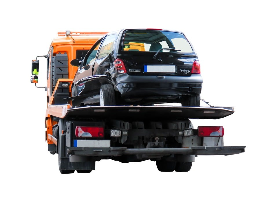 Car on tow truck bed