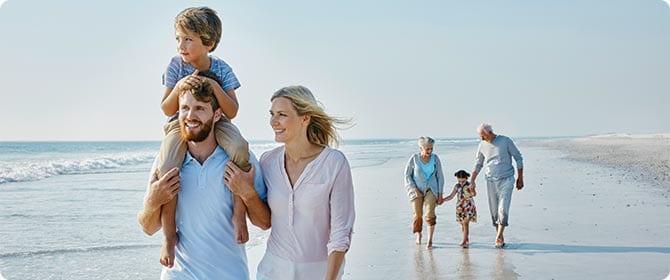 travelex insurance family on beach