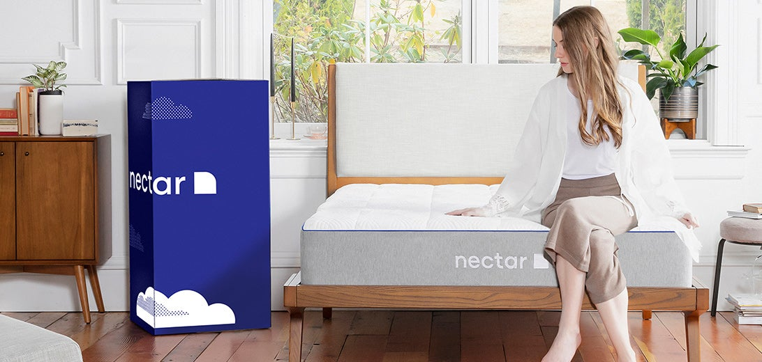 woman setting up mattress bed