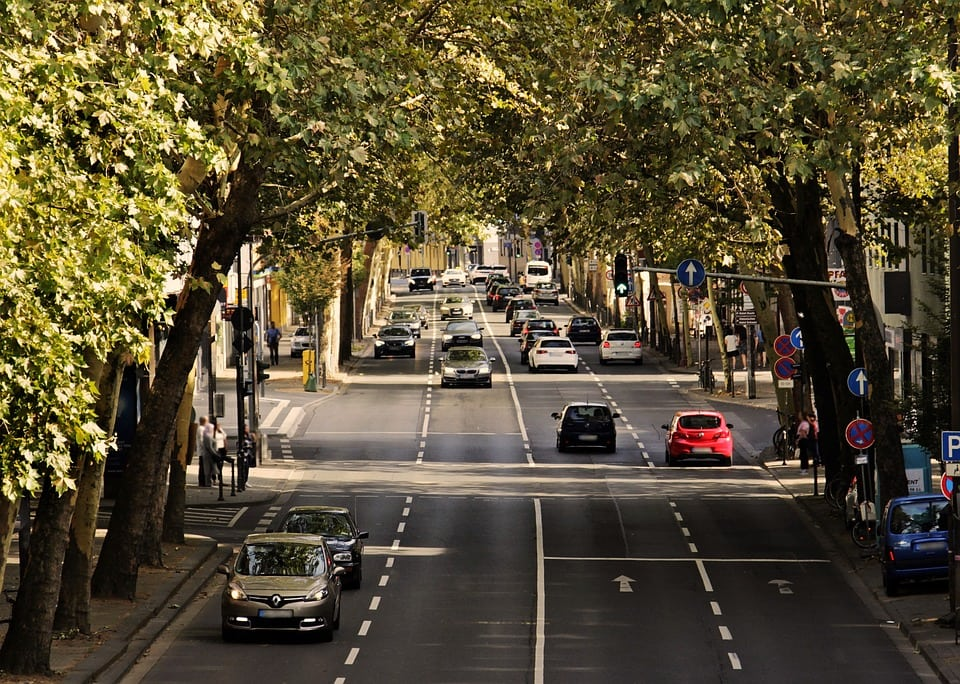 Liberty mutual insurance has three main policies | cars on a tree-lined road