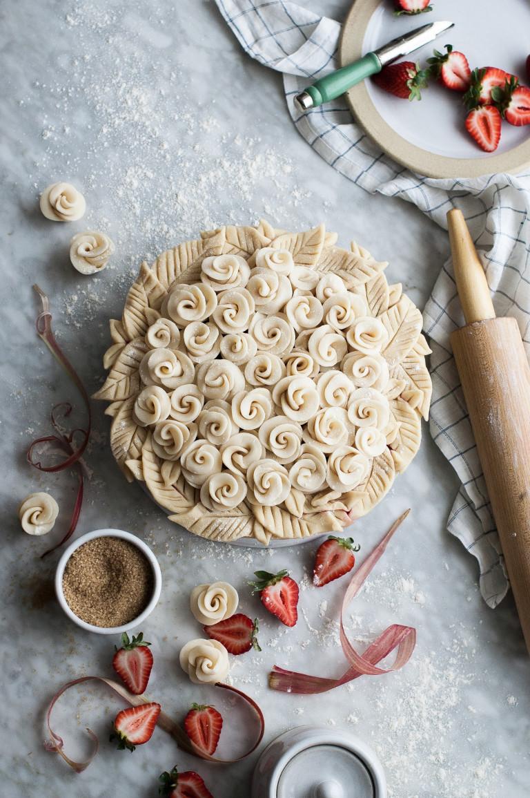 Thanksgiving pie - strawberry-rhubarb-rose- The Kitchen McCabe </p> </div> <p> The Kitchen McCabe looks good, but it tastes great! </p> <h2> Ingredients </h2> <p><strong> Crust </strong></p> <ul> <li> 2 1/2 cup white whole wheat flour </li> <li> 3 Tbsp. fine cane sugar </li> <li> 3 Tbsp. sea salt </li> <li> 1 vanilla bean </li> <li> 1/4 cup shortening </li> <li> 12 Tbsp. (1 1/2 sticks) butter, cold and cut into small cubes </li> <li> 1/4 cup of ice water </li> </ul> <p><strong> Filling </strong></p> <ul> <li> 2 medium-sized rhubarb stalks, sliced </li> <li> 1 lb. 1 cup of turbinado or demerara sugar </li> <li> 5 Tbsp. tapioca starch </li> <li> 1 egg, beaten </li> </ul> <div id=
