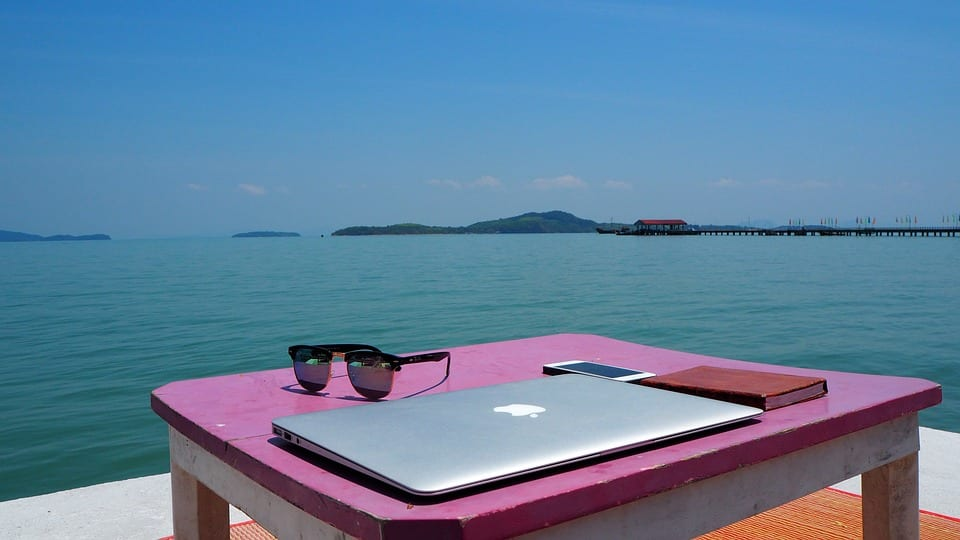 why do i need a wifi booster laptop on table by water