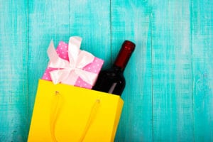 a yellow gift box with wine