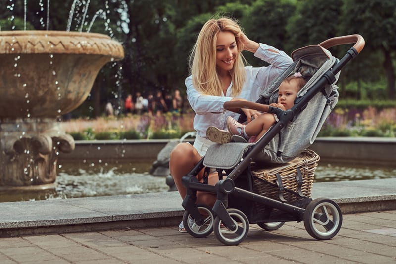 mom with baby in stroller - best baby shower gifts for moms out and about