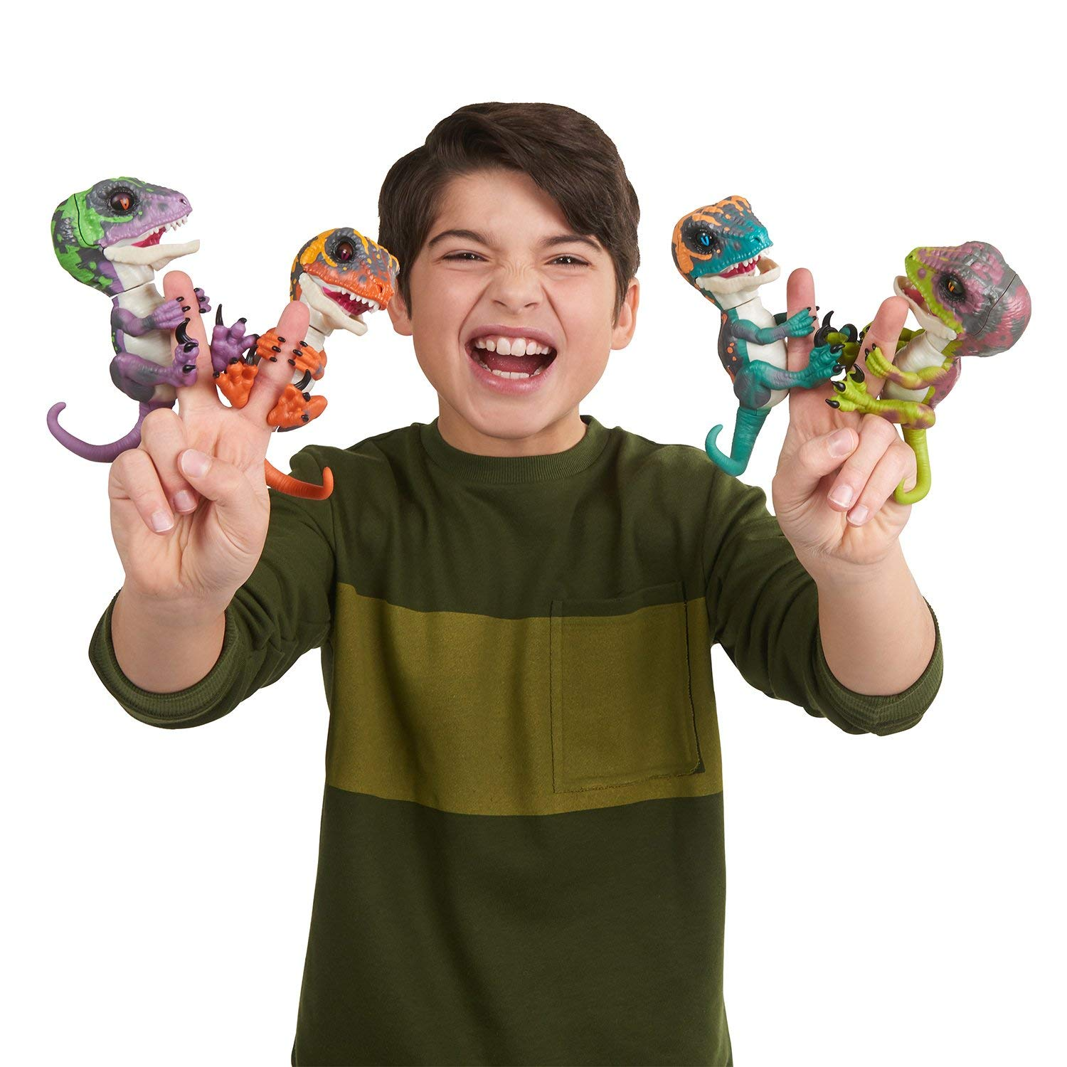 boy with his raptor fingerlings holiday toys