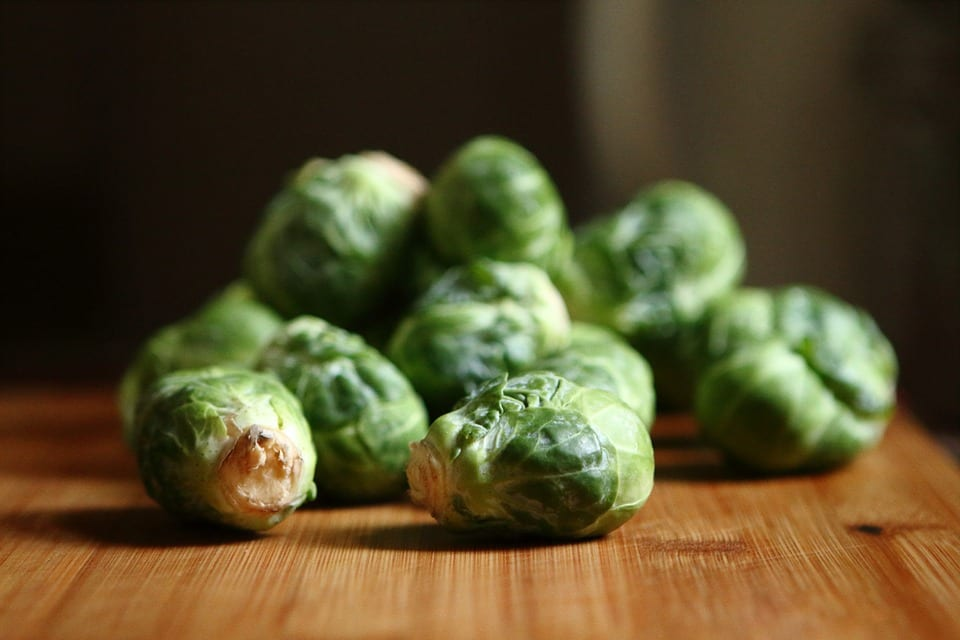 brussel sprouts on a wooden table a zero calorie food