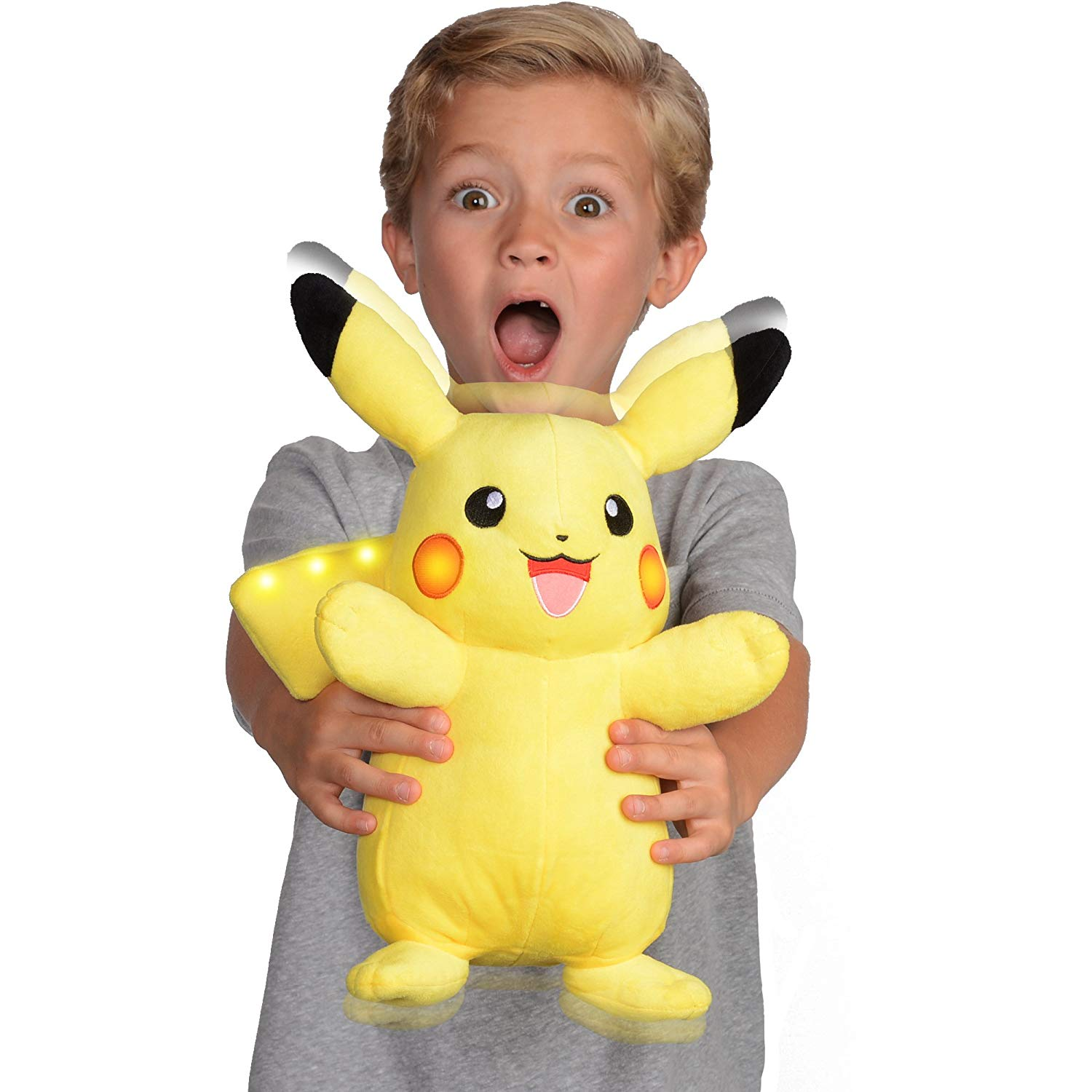 child with one of his favorite holiday toys, pikachu