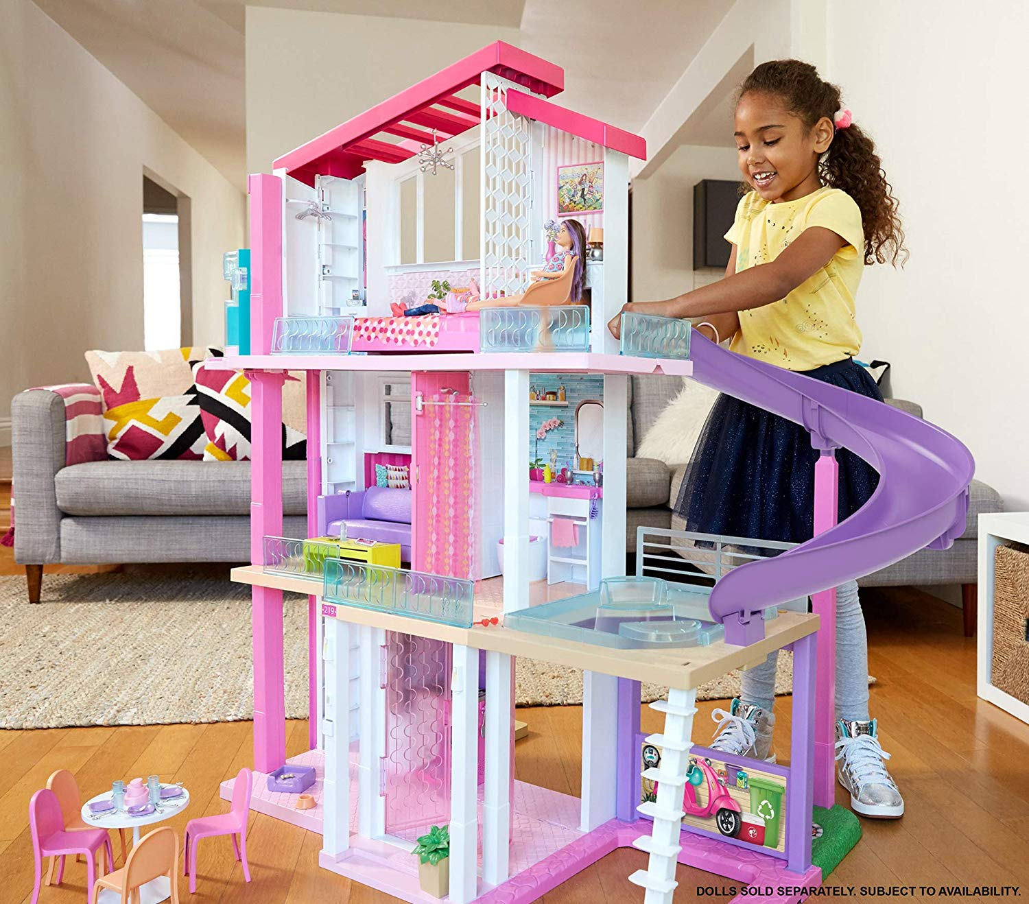 girl playing with her best holiday toy, barbie's dream house