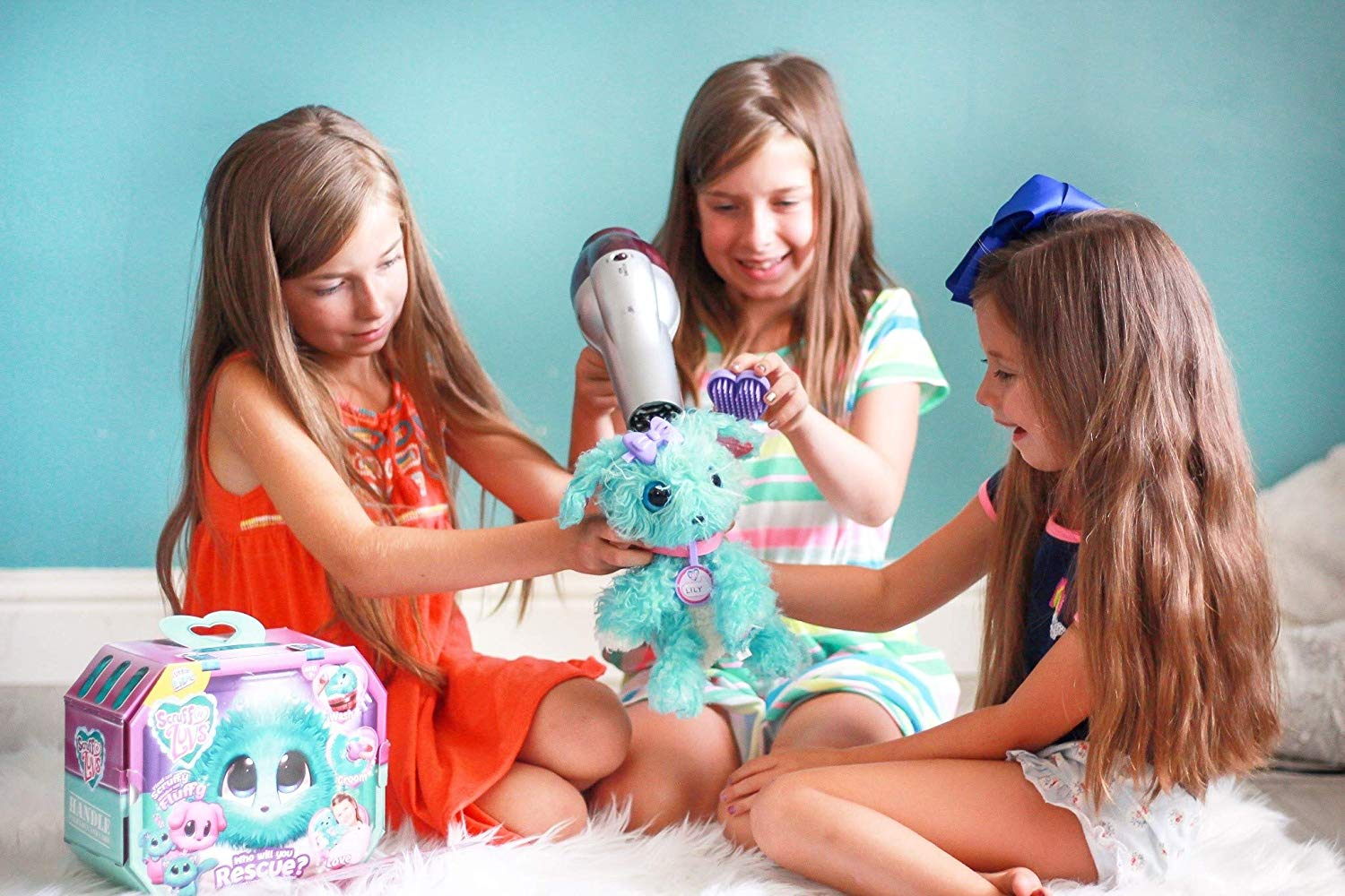 group of girls playing with their scruff-a-luvs holiday toys