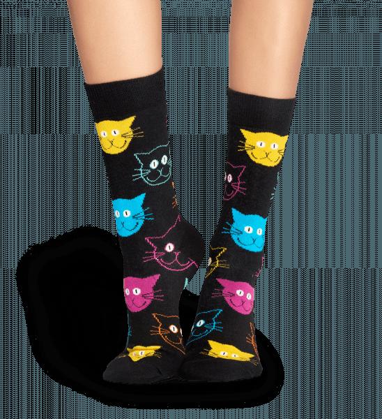 lady wearing her cat sock happy socks