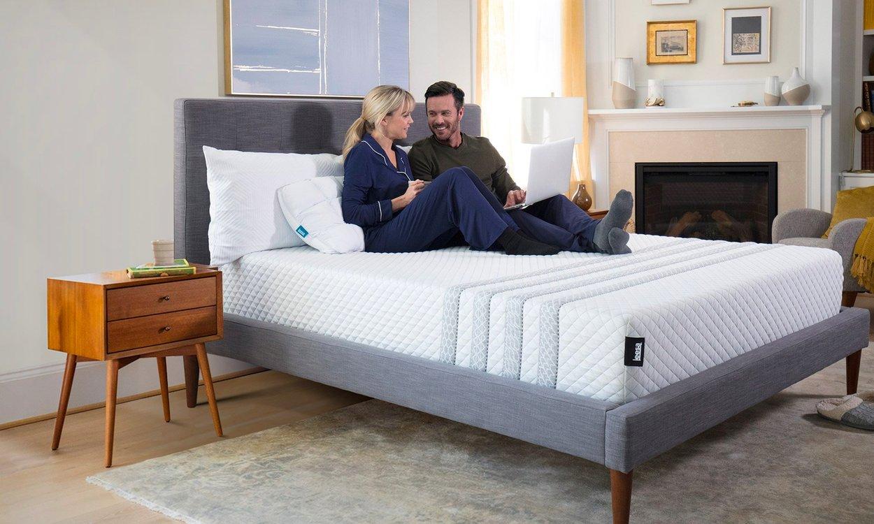 Couple resting on Leesa mattress