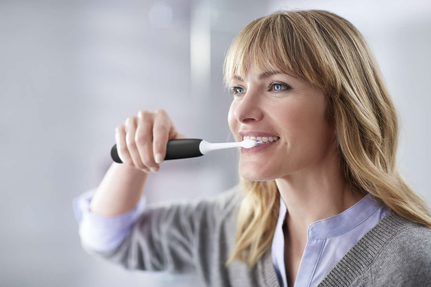 Philips Sonicare ProtectiveClean 5100 - woman brushing her teeth