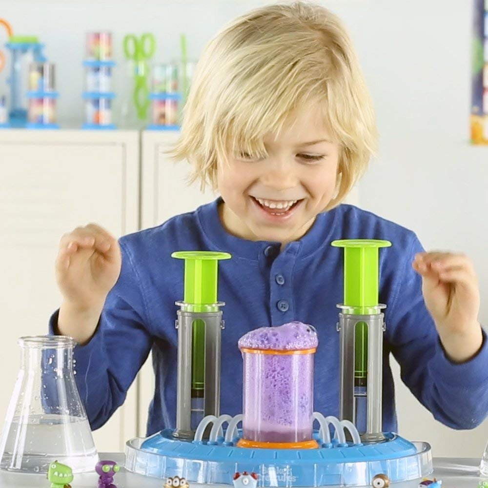 top-choice holiday toys for the learner scientist | kid experimenting with beakers