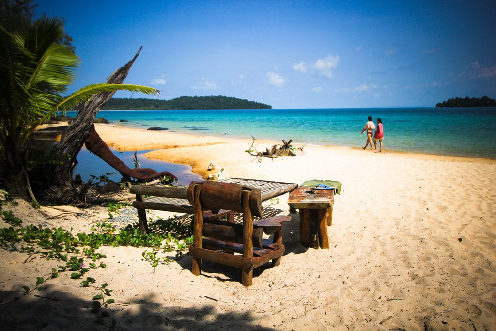 wooden chairs and tables on koh rong island