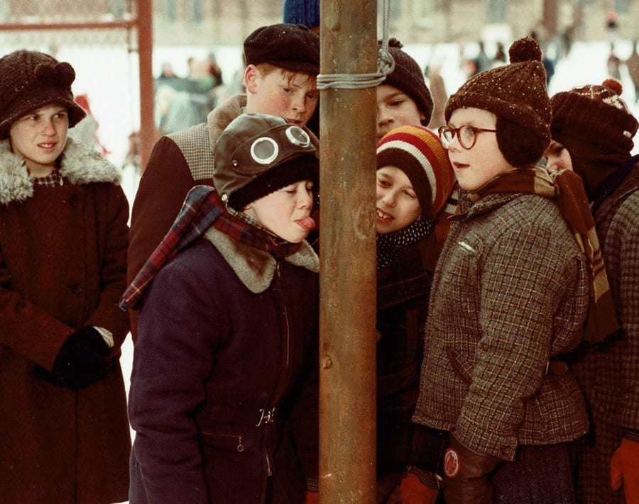 Classic image from A Christmas Story of kids licking frozen pole