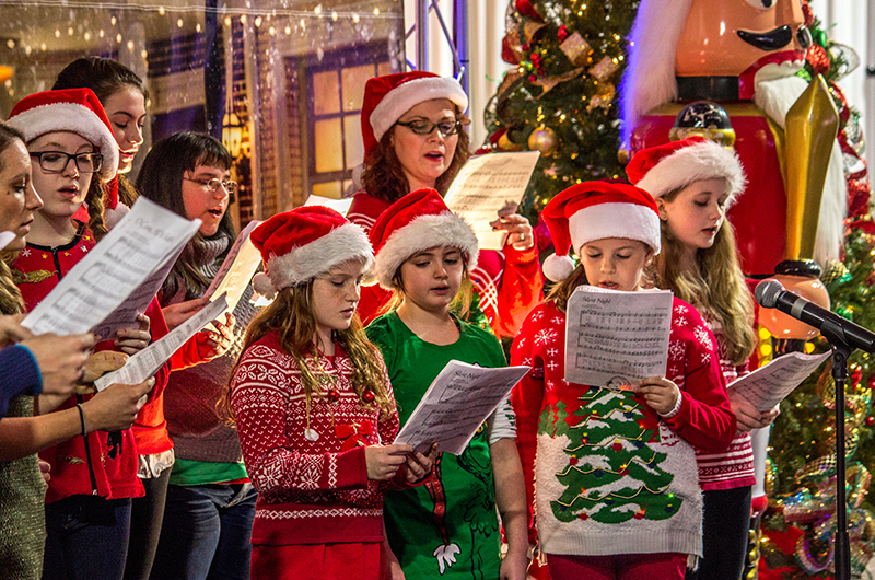 caroling kids christmas traditions