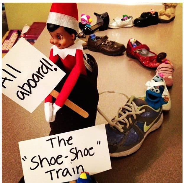 "The elf on the shelf riding a ""shoe train"""