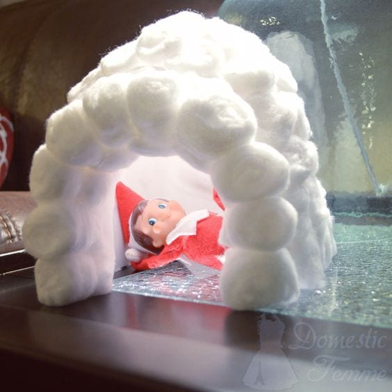 The elf created an igloo out of cotton balls