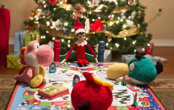 The elf on the shelf is playing a boardgame