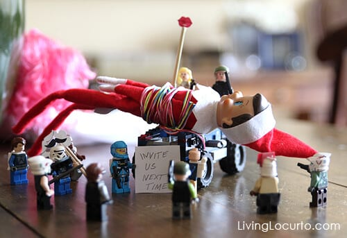 The other toys tied up the elf because he didn't take them to the North Pole