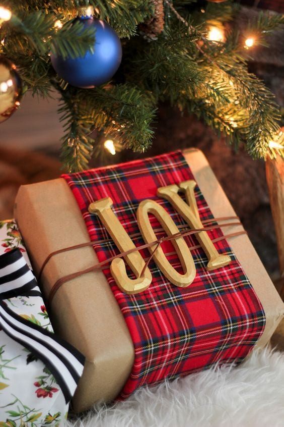 wooden letters and tartan fabric is a wonderful gift wrapping idea