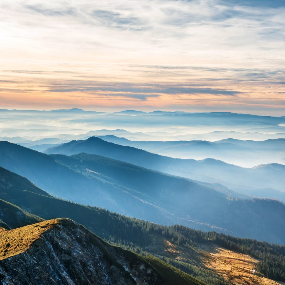 Blue mountains and hills over beautiful sunset a perfect winter vacation in USA