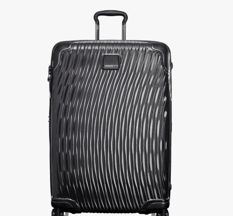 A black hard-sided bag from Tumi