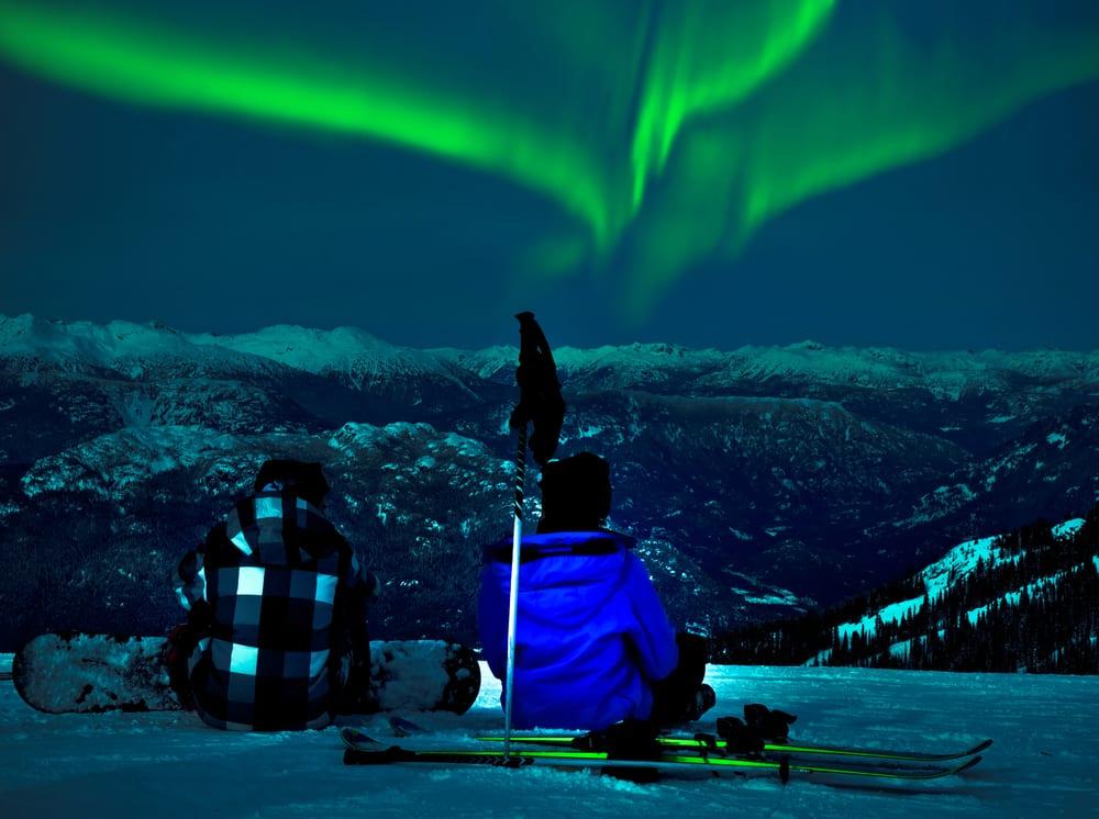 Couple watching the Northern Lights in Fairbanks, Alaska