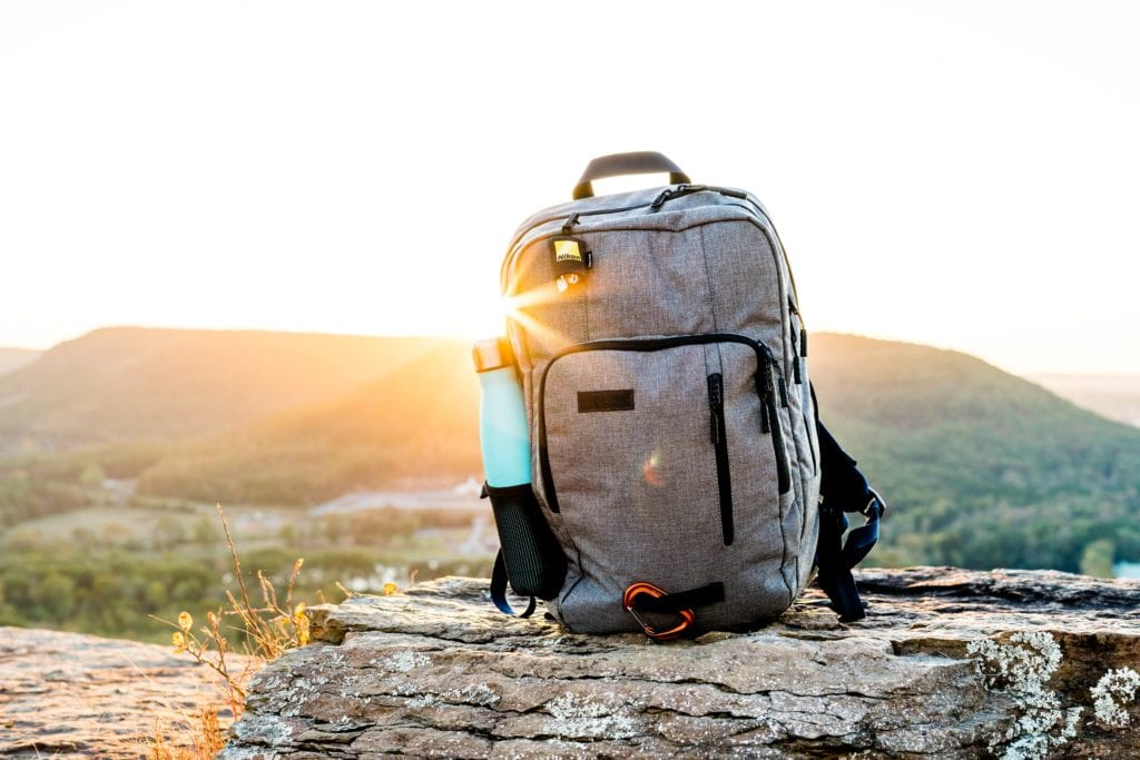 travel backpack on the rocks